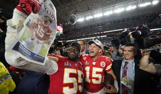 Kansas City Chiefs' Frank Clark, left, and Patrick Mahomes celebrate after defeating the San Francisco 49ers in the NFL Super Bowl 54 football game Sunday, Feb. 2, 2020, in Miami Gardens, Fla. (AP Photo/David J. Phillip)