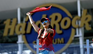 A Kansas City Chiefs fan celebrates before the NFL Super Bowl 54 football game between the Chiefs and the San Francisco 49ers, Sunday, Feb. 2, 2020, in Miami Gardens, Fla. (AP Photo/Chris O'Meara)