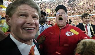 Kansas City Chiefs Chairman Clark Hunt, left, and head coach Andy Reid celebrate after defeating the San Francisco 49ers in the NFL Super Bowl 54 football game Sunday, Feb. 2, 2020, in Miami Gardens, Fla. (AP Photo/David J. Phillip)