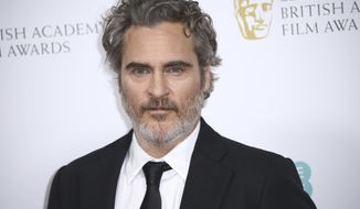 Actor Joaquin Phoenix poses for photographers upon arrival at the Bafta Nominees Party, in central London, Saturday, Feb. 1, 2020. (Photo by Joel C Ryan/Invision/AP)