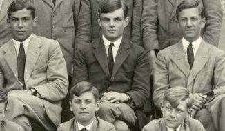 This 1930 photo provided by the Sherborne School in Sherborne, England, shows members of Westcott House, including Alan Turing, center, who went on to become a World War II codebreaker and computing pioneer. The U.S. government is trying to return memorabilia from World War II codebreaker and computing pioneer Alan Turing that were allegedly stolen more than 30 years ago. (Sherborne School via AP)