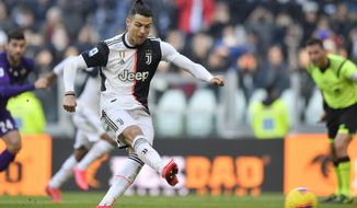 Juventus' Cristiano Ronaldo shoots to score on a penalty during a Serie A soccer match between Juventus and Fiorentina, in Turin, Italy, Sunday, Feb. 2, 2020. (Fabio Ferrari/LaPresse via AP)