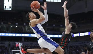 Pittsburgh's Trey McGowens, left, shoots as Miami's Isaiah Wong, right, defends during the first half of an NCAA college basketball game, Sunday, Feb. 2, 2020, in Pittsburgh. (AP Photo/Keith Srakocic)