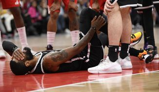 Brooklyn Nets guard Kyrie Irving reacts after he was injured during the second half of an NBA basketball game against the Washington Wizards, Saturday, Feb. 1, 2020, in Washington. (AP Photo/Nick Wass)  **FILE**