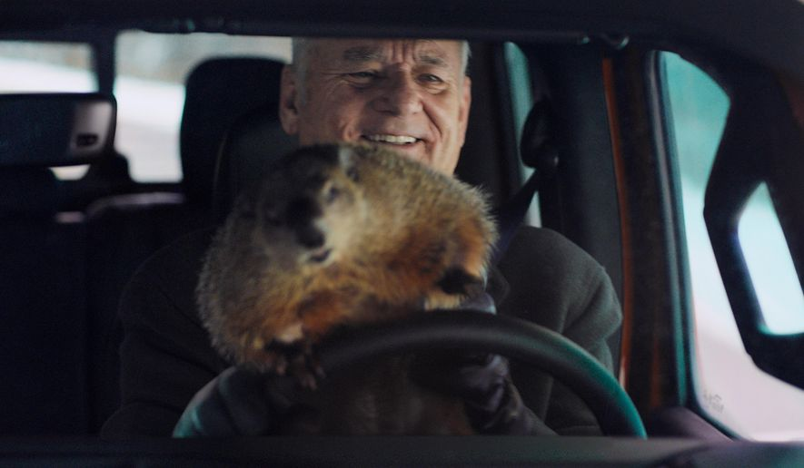 """This undated image provided by Jeep shows Bill Murray reprises his role as Phil Connors from the 1993 film """"Groundhog Day,"""" in a scene from the company's 2020 Super Bowl NFL football spot. (Jeep via AP)"""