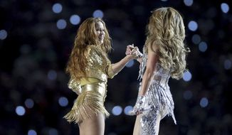 Shakira and Jennifer Lopez shake hands after performing their halftime show at Super Bowl 54 on Feb. 2, 2020, in Miami Gardens, Fla. (AP Photo/Gregory Payan)