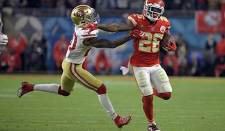 Kansas City Chiefs' Damien Williams, right, pulls away from San Francisco 49ers' Jimmie Ward on his way to the winning touchdown during the second half of the NFL Super Bowl 54 football game Sunday, Feb. 2, 2020, in Miami Gardens, Fla. (AP Photo/Mark J. Terrill)