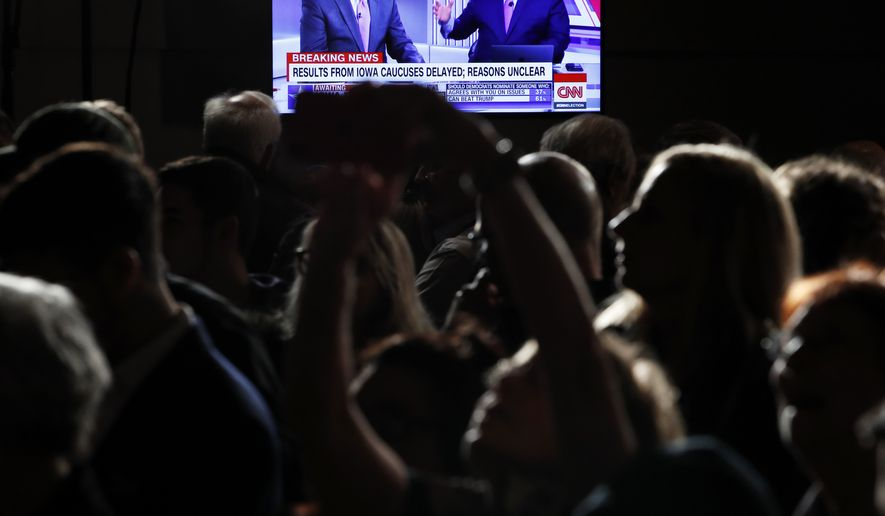 People wait for results at a caucus night campaign rally for democratic presidential candidate former Vice President Joe Biden on Monday, Feb. 3, 2020, in Des Moines, Iowa. (AP Photo/John Locher)