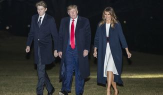 President Donald Trump together with first lady Melania Trump and their son Barron Trump, arrive at the White House, Sunday, Feb. 2, 2020, in Washington from a weekend trip at his Mar-a-Lago estate in Palm Beach, Fla. (AP Photo/Manuel Balce Ceneta)