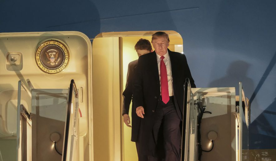President Donald Trump exits Air Force One at Andrews Air Force Base in Md., Sunday, Feb. 2, 2020. The Trumps return from a trip to Florida to spend the weekend at their Mar-a-Lago estate. (AP Photo/Michael A. McCoy)