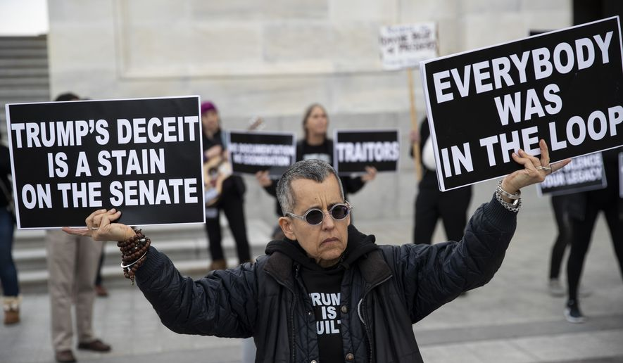 Demonstrators protest outside of the U.S. Capitol. (Associated Press/File)