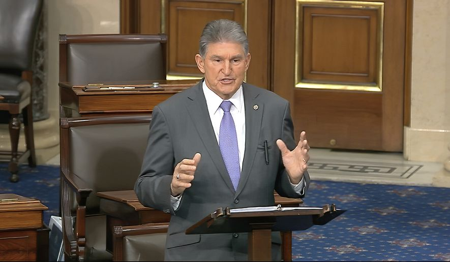 In this image from video, Sen. Joe Manchin, Joe, D-W.Va., speaks on the Senate floor about the impeachment trial against President Donald Trump at the U.S. Capitol in Washington, Monday, Feb. 3, 2020. The Senate will vote on the Articles of Impeachment on Wednesday afternoon. (Senate Television via AP)
