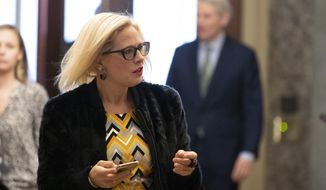 Sen. Kyrsten Sinema, D-Ariz., arrives on Capitol Hill, Monday, Feb. 3, 2020, in Washington. (AP Photo/Alex Brandon) **FILE**
