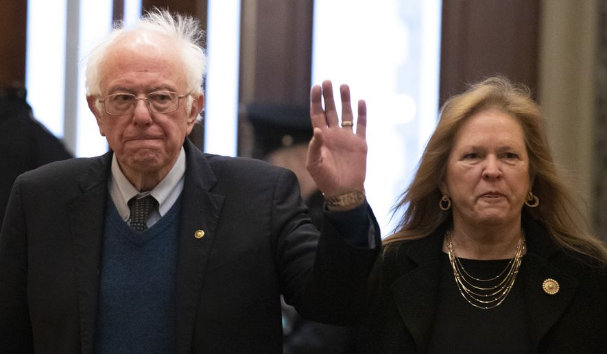 Sen. Bernie Sanders, I-Vt., his wife, Jane O'Meara Sanders, arrive on Capitol Hill, Monday, Feb. 3, 2020, in Washington. (AP Photo/Alex Brandon)