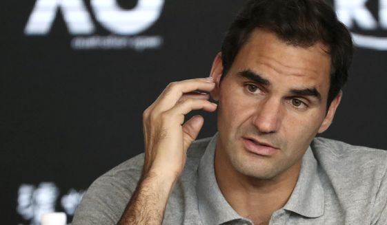 Switzerland's Roger Federer speaks during a press conference following his semifinal loss to Serbia's Novak Djokovic at the Australian Open tennis championship in Melbourne, Australia, Thursday, Jan. 30, 2020. (AP Photo/Dita Alangkara)