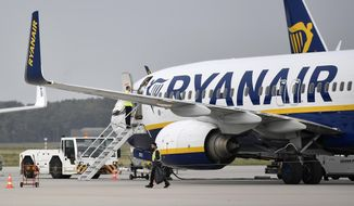 FILE - In this Sept. 12, 2018 file photo, a Ryanair plane parks at the airport in Weeze, Germany. Europe's busiest airline, Ryanair, said Monday Feb. 3, 2020, that the grounding of the new Boeing Max jets will delay its growth targets. The budget carrier, which is based in Ireland and carries more passengers than any other airline in Europe, plans to extend by a year or two its target of flying 200 million people per year. (AP Photo/Martin Meissner, File)