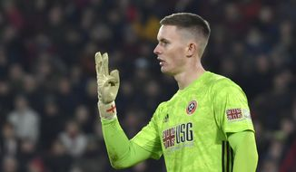 Sheffield United's goalkeeper Dean Henderson gestures during the English Premier League soccer match between Sheffield United and Manchester City at Bramall Lane in Sheffield, England, Tuesday, Jan. 21, 2020. (AP Photo/Rui Vieira)