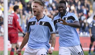 Lazio's Ciro Immobile, left, celebrates after scoring his side's opening goal during the Serie A soccer match between Lazio and Spal, at the Rome Olympic Stadium Sunday, Feb. 2, 2020. (Alfredo Falcone/Lapresse via AP)
