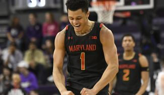 Maryland guard Anthony Cowan Jr. (1) gestures after making a three point basket against Northwestern during the second half of an NCAA college basketball game, Tuesday, Jan. 21, 2020, in Evanston, Ill. (AP Photo/David Banks) ** FILE **