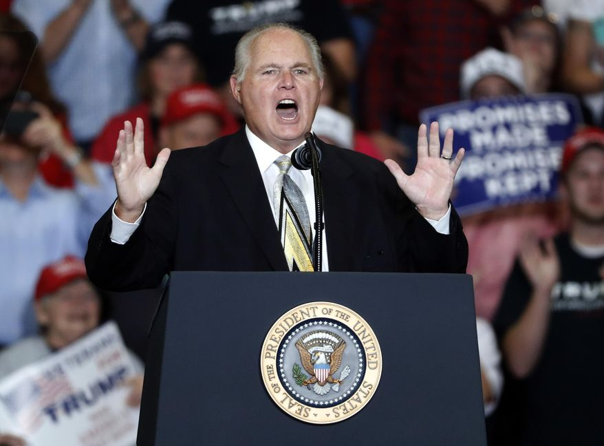 This Nov. 5, 2018 file photo shows radio personality Rush Limbaugh introducing President Donald Trump at the start of a campaign rally in Cape Girardeau, Mo. (AP Photo/Jeff Roberson, File)