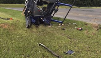 This file image provided by the South Carolina Law Enforcement Division shows a helicopter that crashed at Summerville Airport on June 26, 2019, in Summerville, S.C. Last summer's crash of the South Carolina state police helicopter came about after a co-pilot left a control pedal locked and didn't tell the pilot, federal investigators have determined. (South Carolina Law Enforcement Division via AP, File)