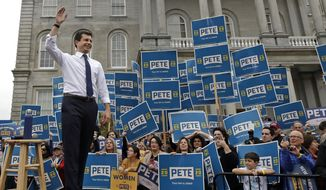 Democratic presidential candidate South Bend, Ind., Mayor Pete Buttigieg waves to supporters outside the Statehouse, Wednesday, Oct. 30, 2019, in Concord, N.H., after filing to be placed on the New Hampshire primary ballot. (AP Photo/Elise Amendola)