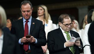 House Impeachment Manager Rep. Adam Schiff, D-Calif., left, types on a device, as House Impeachment Manager and Judiciary Committee Chairman Rep. Jerrold Nadler, D-N.Y., right, reads a pocket copy of the U.S. Constitution as they wait for President Donald Trump to arrive and deliver his State of the Union address to a joint session of Congress in the House Chamber on Capitol Hill in Washington, Tuesday, Feb. 4, 2020. (Leah Millis/Pool via AP)