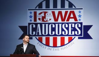 Iowa Democratic Party chairman Troy Price speaks about the delay in Iowa caucus results, Tuesday, Feb. 4, 2020, in Des Moines, Iowa. (AP Photo/Charlie Neibergall)