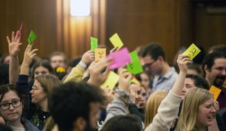 University of Iowa students hold up numbered cards while they caucus, Monday, Feb. 3, 2020, at the Iowa Memorial Union in Iowa City, Iowa. (Joseph Cress/Iowa City Press-Citizen via AP)