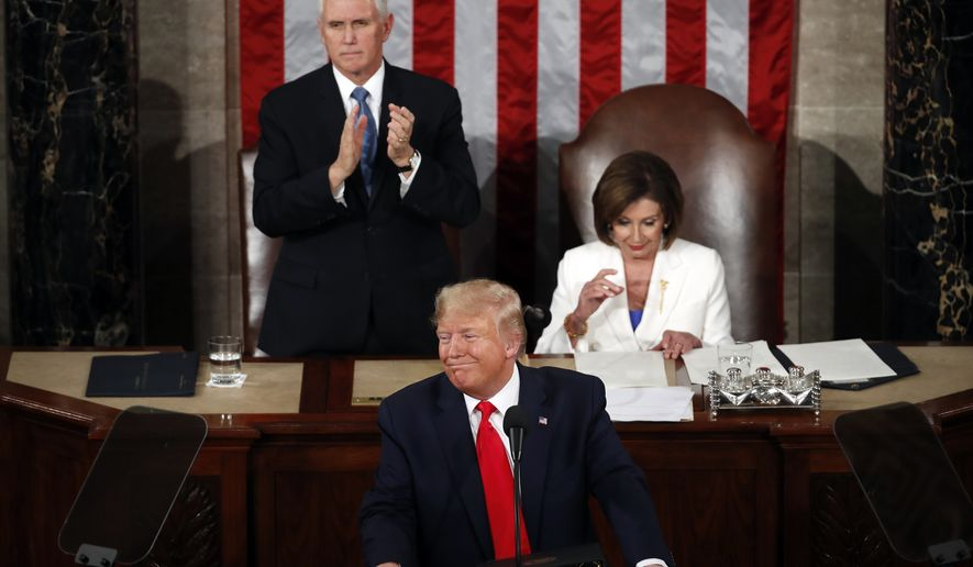 President Donald Trump delivers his State of the Union address to a joint session of Congress on Capitol Hill in Washington, Tuesday, Feb. 4, 2020, as Vice President Mike Pence and House Speaker Nancy Pelosi of Calif., watch. (AP Photo/Alex Brandon)