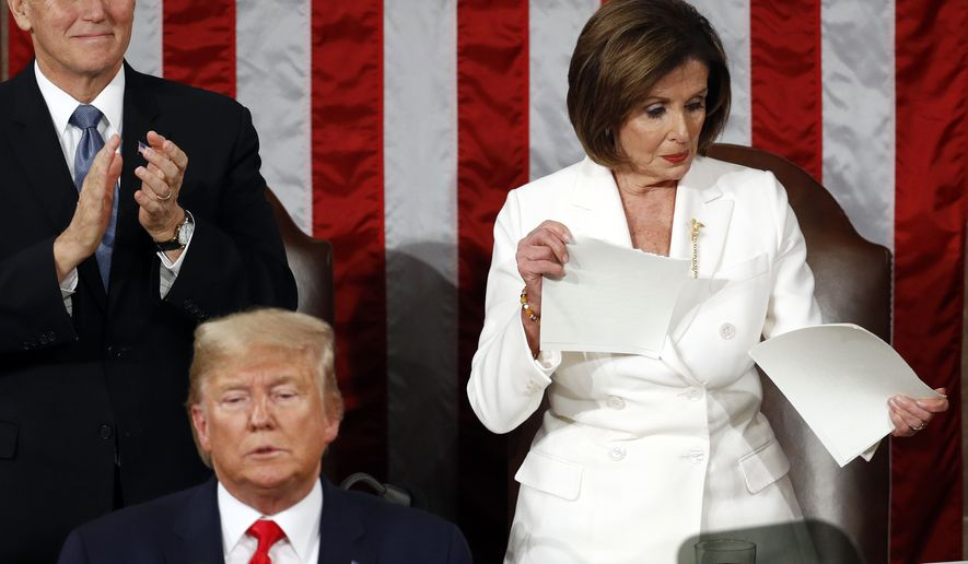 House Speaker Nancy Pelosi of Calif., tears her copy of President Donald Trump's s State of the Union address after he delivered it to a joint session of Congress on Capitol Hill in Washington, Tuesday, Feb. 4, 2020. Vice President Mike Pence is at left. (AP Photo/Patrick Semansky)