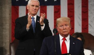 President Donald Trump delivers his State of the Union address to a joint session of Congress in the House Chamber on Capitol Hill in Washington, Tuesday, Feb. 4, 2020, as Vice President Mike Pence applauds. (Leah Millis/Pool via AP)