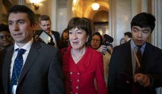 Sen. Susan Collins, R-Maine, center, departs as Republican senators leave a closed-door strategy session at the Capitol in Washington, Tuesday, Feb. 4, 2020. They are expected to acquit President Donald Trump tomorrow on impeachment charges of abuse of power and obstruction of Congress. (AP Photo/J. Scott Applewhite)