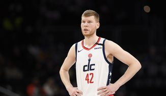 Washington Wizards forward Davis Bertans (42) stands on the court during the second half of an NBA basketball game against the Golden State Warriors, Monday, Feb. 3, 2020, in Washington. The Warriors won 125-117. (AP Photo/Nick Wass) ** FILE **