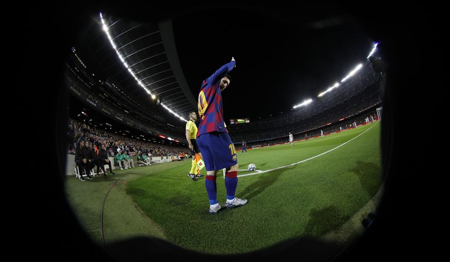 Barcelona's Lionel Messi prepares to take a corner kick during a Spanish La Liga soccer match between Barcelona and Levante at the Camp Nou stadium in Barcelona, Spain, Sunday Feb. 2, 2020. (AP Photo/Joan Monfort)