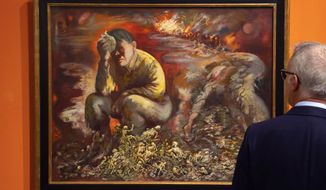 """A man looks at a 1944 painting """"Cain or Hitler in Hell"""", by George Grosz, during a press preview at the German Historical Museum in Berlin, Germany, Tuesday, Feb. 4, 2020. The 1944 painting, which will become part of a new permanent exhibition, depicts a broken Hitler sitting among skeletons as war rages behind him, and helps illustrate """"how Grosz further developed his critical form after emigration,"""" said Markus Hilgert, a senior German cultural official.  (AP Photo/Jens Meyer)"""