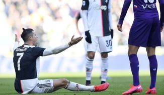 Juventus' Cristiano Ronaldo sits on the ground as he argues during a Serie A soccer match between Juventus and Fiorentina, in Turin, Italy, Sunday, Feb. 2, 2020. (Fabio Ferrari/LaPresse via AP)