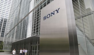 In this July 19, 2019, file, photo, people walk out from the headquarters of Sony Corp., in Tokyo. Japanese electronics and entertainment company Sony reports October-December profit dipped to about half of what it was the previous year as its video-game, networking and film businesses stumbled. (AP Photo/Koji Sasahara, File)