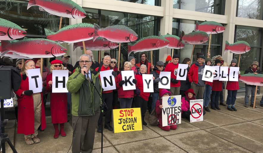 Oregon state Sen. Jeff Golden speaks to demonstrators opposed to a plan to build a natural gas pipeline and marine export terminal in Oregon, at the Department of State Lands in Salem, Ore., Tuesday, Feb. 4, 2020. Golden said he expects the battle to go to the courts if the Trump administration tries to ram the project through despite denials of state permits. Demonstrators held signs depicting salmon, which environmentalists say are among fish species that would be impacted by the proposed 230-mile (370-kilometer) feeder pipeline and export terminal. (AP Photo/Andrew Selsky)