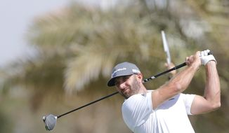 American Dustin Johnson follows his ball at the 6th hole during the third round of the Saudi International at Royal Greens Golf and Country Club, Saturday, Feb. 1, 2020, in Red Sea resort of King Abdullah Economic City, Saudi Arabia. (AP Photo/Amr Nabil)