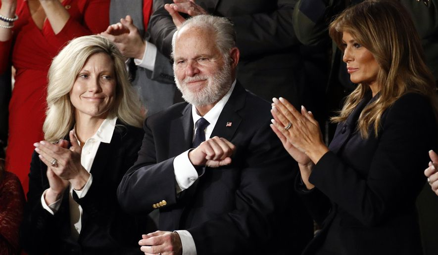Rush Limbaugh reacts as first Lady Melania Trump, and his wife Kathryn, applaud, as President Donald Trump delivers his State of the Union address to a joint session of Congress on Capitol Hill in Washington, Tuesday, Feb. 4, 2020. (AP Photo/Patrick Semansky)