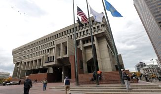 Flags fly at half-staff outside City Hall in Boston, Thursday, Oct. 30, 2014 to mourn the death of former Boston Mayor Thomas Menino. (AP Photo/Elise Amendola)  **FILE**