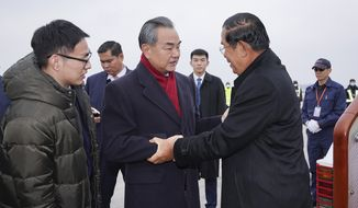 Cambodian Prime Minister Hun Sen (right) visited China last week while officials in Beijing and Wuhan were reporting alarming increases in deaths and infections from the novel coronavirus. (Associated Press)