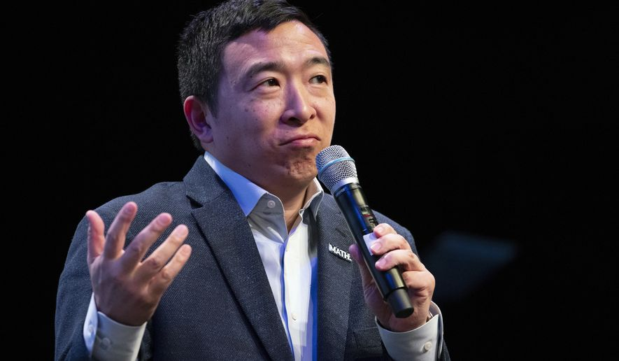 Andrew Yang pauses as he speaks during the New Hampshire Youth Climate and Clean Energy Town Hall, Wednesday, Feb. 5, 2020, in Concord, N.H. (AP Photo/Mary Altaffer)