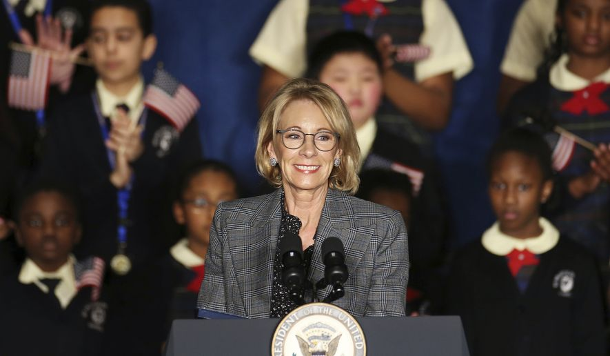 Secretary of Education Betsy DeVos speaks at St. Francis de Sales School in West Philadelphia on Wednesday, Feb. 5, 2020. DeVos and Vice President Mike Pence were at the school for an event about school choice. (Tim Tai/The Philadelphia Inquirer via AP) **FILE**