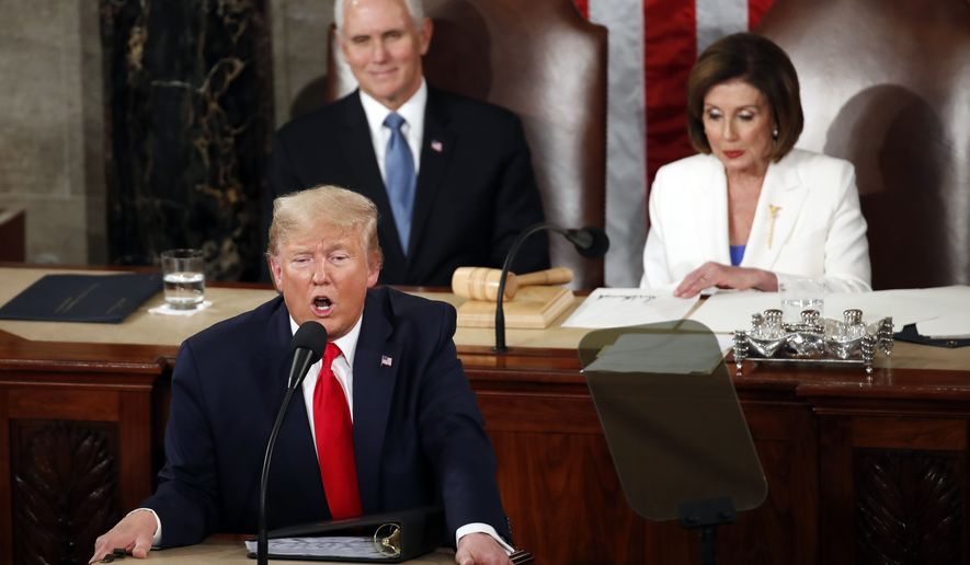 President Donald Trump delivers his State of the Union address to a joint session of Congress on Capitol Hill in Washington, Tuesday, Feb. 4, 2020, as Vice President Mike Pence listens and House Speaker Nancy Pelosi of Calif., reads. (AP Photo/Alex Brandon)