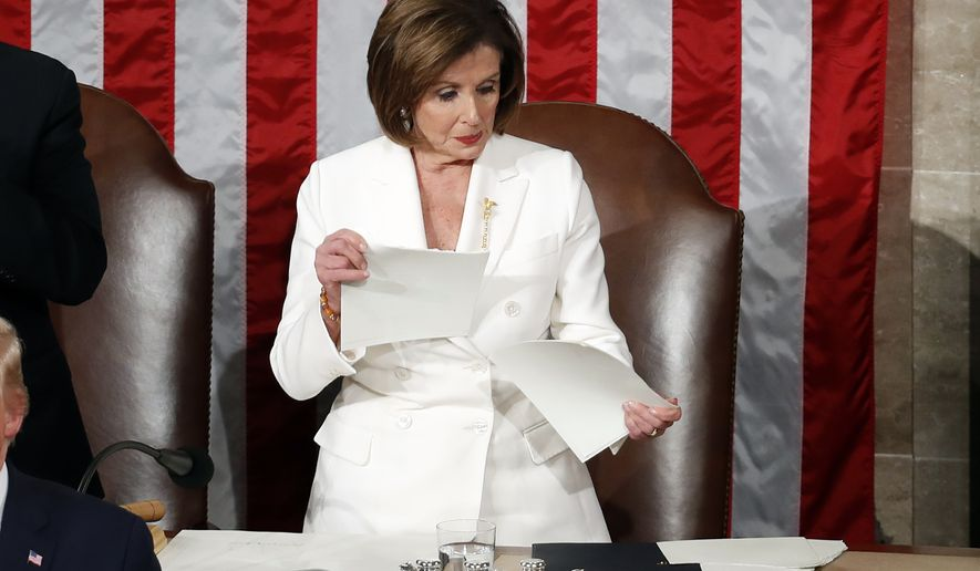 House Speaker Nancy Pelosi of Calif., tears up a copy of President Donald Trump's State of the Union address on Capitol Hill in Washington, Tuesday, Feb. 4, 2020. (AP Photo/Alex Brandon)