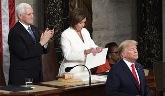 House Speaker Nancy Pelosi of Calif., tears her copy of President Donald Trump's s State of the Union address after he delivered it to a joint session of Congress on Capitol Hill in Washington, Tuesday, Feb. 4, 2020. Vice President Mike Pence is at left. (AP Photo/Susan Walsh)