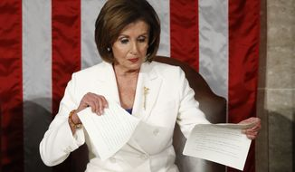House Speaker Nancy Pelosi of Calif., tears her copy of President Donald Trump's State of the Union address after he delivered it to a joint session of Congress on Capitol Hill in Washington, Tuesday, Feb. 4, 2020. (AP Photo/Patrick Semansky)