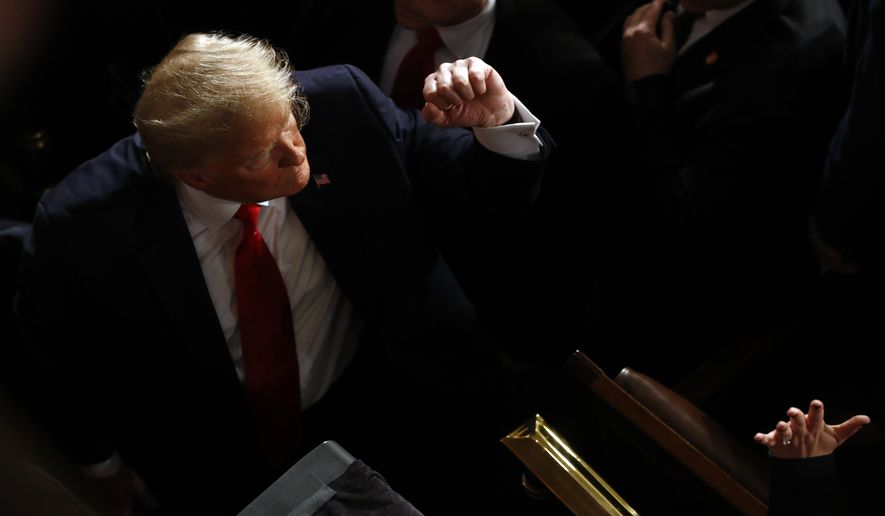 President Donald Trump greets people after delivering his State of the Union address to a joint session of Congress on Capitol Hill in Washington, Tuesday, Feb. 4, 2020. (AP Photo/Patrick Semansky)